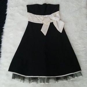 Black short strapless dress.